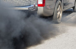 Air pollution from vehicle on road Stock Image