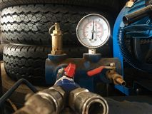 Air pressure gauge. In car service center Royalty Free Stock Photo