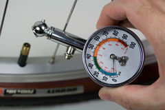 Air Pressure Gauge and Bicycle Tire Royalty Free Stock Image