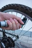 Air pump on bicycle tire by hand stock photos