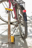 Air pump and bicycle tire. Royalty Free Stock Image