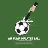 Air Pump Inflates Ball. Stock Photo