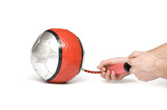 Air pump inflates ball Stock Image