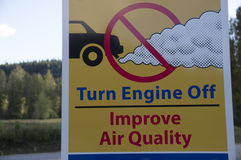 Air Quality Sign. Improve Air Quality Turn off engine Sign at roadside rest stop in British Columbia, Canada with forest tree background Royalty Free Stock Photos