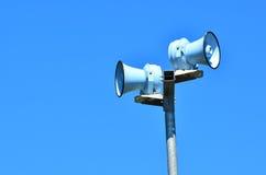 Air raid siren against blue sky. Air raid siren , against blue sky for emergency hazard of: tsunami, war, fire and flood Stock Photos