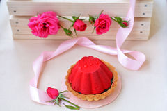 Air and red cake with chocolate near pink ribbon, rose. On foreground Royalty Free Stock Image