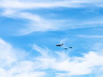 Air refueling of fighter aircrafts in white clouds Royalty Free Stock Photos