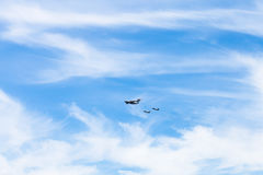 Air refueling of fighter airplanes in white clouds Royalty Free Stock Photos