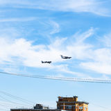 Air refueling turboprop bomber over urban house Royalty Free Stock Photography