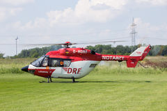 Air rescue helicopter. AHLEN, GERMANY - JUN 5, 2016: DRF Luftrettung (German Air Rescue) BK-117 helicopter landing at Ahlen-Nord heliport royalty free stock image