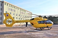 Air rescue service. Helicopter air ambulance on heliport. Catania, ITALY - 01 April 2019. Emergency medical service helicopter resting on helipad of the hospital royalty free stock image
