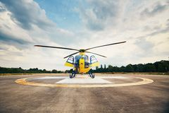 Air rescue service. Helicopter air ambulance is ready for take off at the heliport royalty free stock image