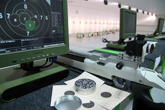 Air rifle and 10m target monitor Royalty Free Stock Photo