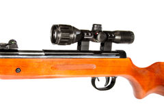 Air rifle with a telescopic sight and a wooden butt Stock Photo