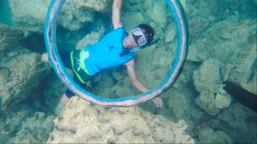 Air ring,scuba diving. Scuba diver made air ring in water.Travel concept,Adventure concept.Slow motion stock footage