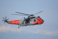 Air / Sea Rescue. Royal Navy Air/Sea Rescue Helicopter in Flight at Southport Airshow royalty free stock photography
