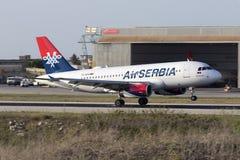 Air Serbia touching down. Luqa, Malta - 12 July 2016: Air Serbia Airbus A319-132 [YU-APA] landing runway 13 Royalty Free Stock Images