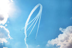 Air show. Four air show fighter planes in the sky making a figure Royalty Free Stock Photos