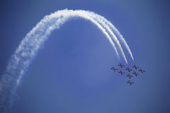 Air Show. The view of several jet plane in formation. White smoke tail on the blue sky background Royalty Free Stock Photography