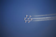 Air Show. The view of several jet planes in formation on the blue sky background Stock Image