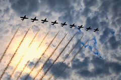 Air Show. The view of several jet planes in formation on the cloudy sky background Royalty Free Stock Images