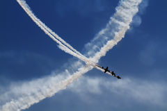 Air Show. The view of the whit plane trails on the blue sky background Royalty Free Stock Photos