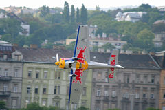 Air show. Peter Besenyei in hungarian air-show over the Danube royalty free stock photography