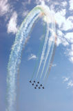 Air show. A team of nine airplanes performing difficult maneuver on an air show Royalty Free Stock Images