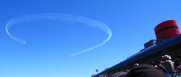 Air Show. Airplanes in the air show go through their formations high in the sky Stock Photo