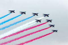 Air show. French Air Force Aerobatic Team performs aerobatic maneuver near Kuala Lumpur royalty free stock image