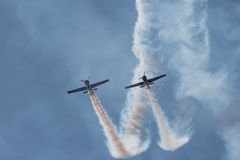 Air show. Dangerous blue plane flight precision circle wings synchronized airshow aerobatic team aviation formation wing airplane smoke teamwork squadron show Stock Photo