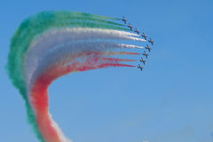 Air show in Italy. Grado, Italy - 13 August, 2016: amazing spectacular air show in Italy, nine ace pilots performing cool tricks in the air, releasing colorful Royalty Free Stock Photos