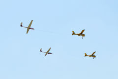 Air show planes formation carrying gliders Stock Photos