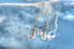 Air show planes. Formation of seven airplanes flying in unison at the Athens air show, 2014, Greece Royalty Free Stock Photos