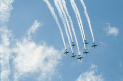 Air show planes. Formation of seven airplanes flying in unison at the Athens air show, 2014, Greece Royalty Free Stock Images