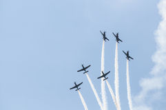 Air show planes. Formation of six airplanes flying in unison at the Athens air show, 2014, Greece Royalty Free Stock Photos