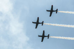 Air show planes. Formation of three airplanes flying in unison at the Athens air show, 2014, Greece Royalty Free Stock Images