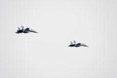Air show in the sky above the Krasnodar airport flight school. Airshow in honor of Defender of the Fatherland. su-35 in the sky. Krasnodar, Russia - February 23 Stock Photo