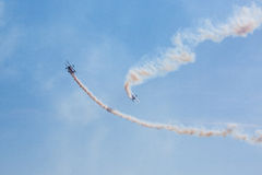Air show with smoke. Team of propeller air-planes with smoke at Bristol International Balloon Fiesta Stock Image