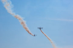Air show with smoke. Team of propeller air-planes with smoke at Bristol International Balloon Fiesta Stock Photos