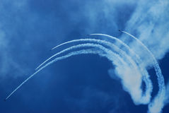 Air show team. A team of five airplanes flying high up in the sky on an air show Stock Image