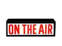 On Air Sign. A production On Air Sign with red letters,over white Stock Image