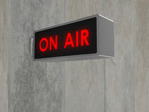 On Air sign. Illustration of an 'On Air' sign, with illuminated red text. Sign is mounted on a concrete wall - also available isolated on white Stock Image
