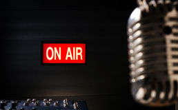 On air signboard in sound studio. Lighting of on air signboard in sound studio and retro  microphone is foreground Stock Image
