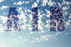Air - sky background with the word air. A shot of a beautiful sky and the word air on it Stock Photo