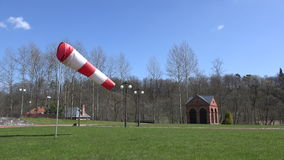 Air sleeve windsock show direction of wind in park. 4K stock video footage
