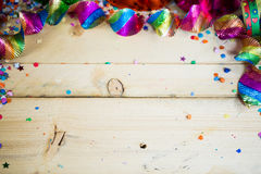 Air snakes and confetti on wooden background Stock Image