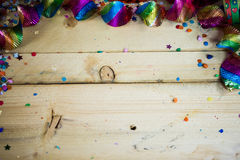 Air snakes and confetti on wooden background Royalty Free Stock Photo