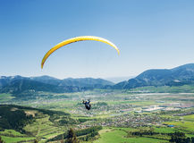 Air sportsman fly on paraplane over the mountain valley Royalty Free Stock Photography