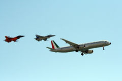 Air squadron. An air squadron formed by F16 of Dutch Air Force, F16 of Belgian Air Force and a DC10 Alitalia with vintage signs in the blu sky at the Roma Stock Image